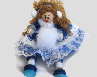 Blue dress button doll