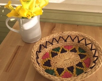 Vibrant woven basket-perfect for serving breads, or bright home decor!