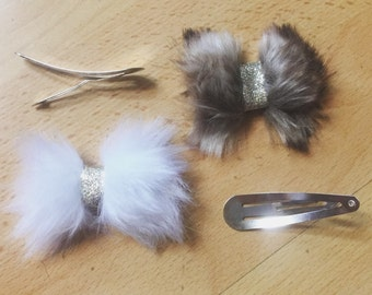 Furr bow or feathered clip