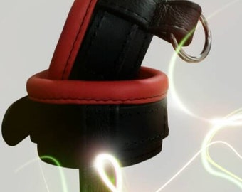 Leather wrist cuffs padded red with ring