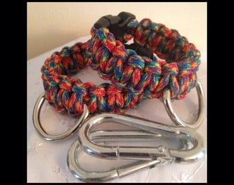BDSM Wrist Cuffs,with clips,D Rings,Multi coloured paracord,Buckle fasteners,submissive,slave,kinky,