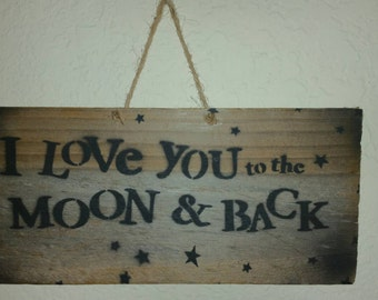 "I love you to the moon and back rustic sign simple but very nice. This measures 11"" width x 5"" in height hand made from 100% pallet wood!"