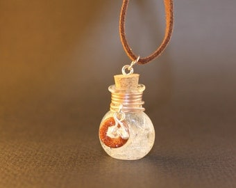 Goldstone and clear crystal necklace