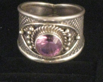 A stylish amethyst sterling silver ring. Size 7 3/4