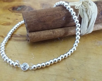 Stretchy Sterling Silver 3mm Ball Bracelet with a Sterling Silver and Cubic Zirconia Bezel