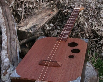 3 string slide guitar