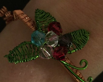Copper weave bracelet with floral accents