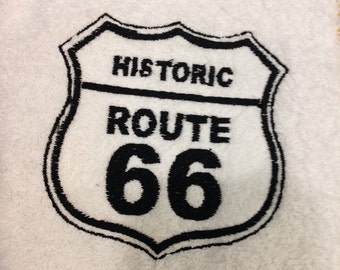 White hand towel embroidered Route 66. Black & white