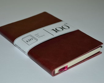 Red leather notebook (A6ish 135mm by 91mm)