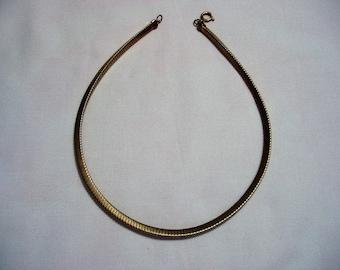 gold tone necklace snake like trangular shape