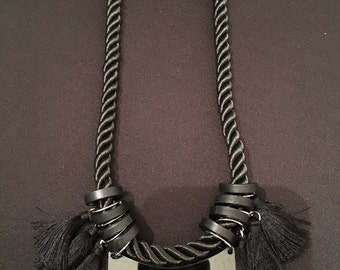Black rope and tassel necklace