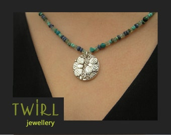 Gemstone beaded necklace with fine silver pendant