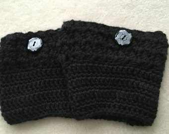 Black boot cuffs with black flower button