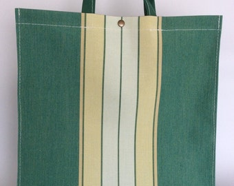 Green bag with vertical stripes made with awning canvas