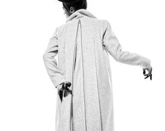 Grey wool coat with details at the back and long collar