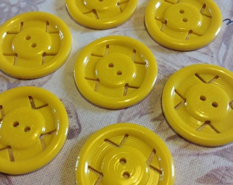 Yellow 1940s American casein vintage buttons wheel design