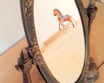 Wonderful make-up mirror made of cast iron