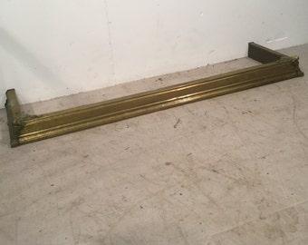 Decorative brass fire fender surround