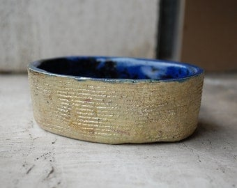 Raku ceramic bowl blue and gold