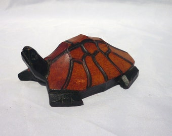 This unconventional hand-carved and painted turtle