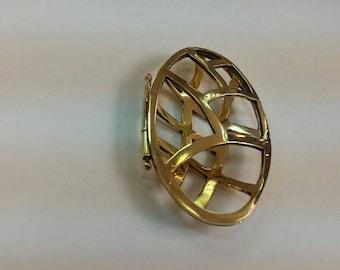 Airy brass locket