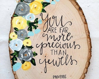 You are far more precious than jewels quote with flower placement.