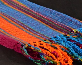 Hand-loomed, fringed, wool scarf.