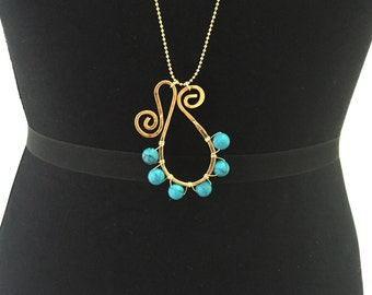6 Semiprecious Turquoise Stones with a handmade 18k Gold plated ornament and a 14k gold beaded chain