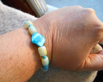 turquoise bracelet with mother of pearl shell focal