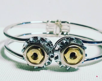 This bracelet is made of brass and stainless steel hardware