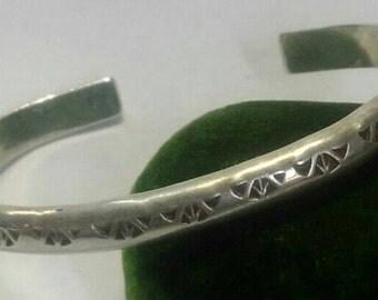 Sterling silver navaho cuff bracelet marked R -- Rob Tsosie?