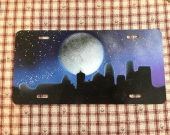 Cityscape License Plate Spray Paint Art