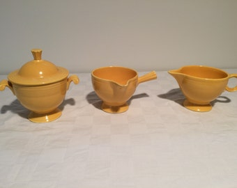 Fiestaware Covered Sugar Bowl and Two Creamers