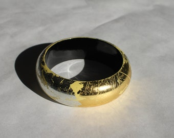Cute vintage lacquered lightweight wood or paper mache bangle with gold and silver leaf on yellow, black interior