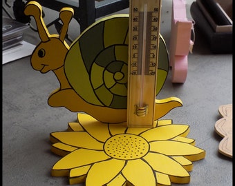Handpainted wooden decoration with thermometer