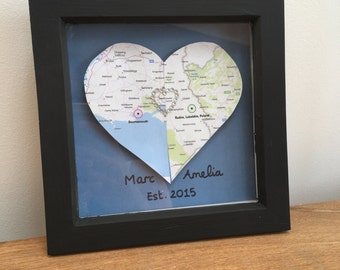 Two map hearts with diamanté heart link in frame