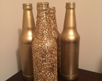 Beautiful gold glitter soda bottles