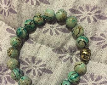 Sea Green beaded bracelet with a Buddha head