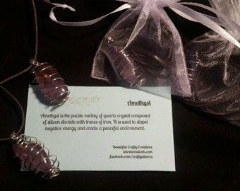 Amethyst Pendant in a silver colored wire cage.