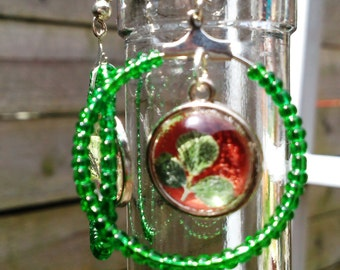 Handmade beaded round big earrings with pressed clover