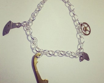 Silver charm bracelet with vintage watch movement charms
