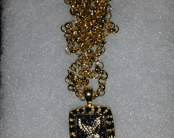 gold colored eagle necklace