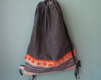 Backpack in cotton with small PomPoms
