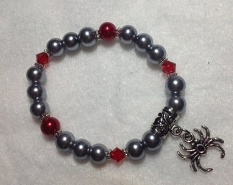 Faux pearl and crystal bracelet with spider charm