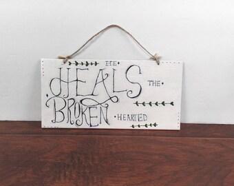He Heals The Broken Hearted Hanging Sign