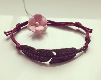 Bracelet with large spring in bordeaux, waxed cotton, vintage, statement, blogger, feather, fly, bird