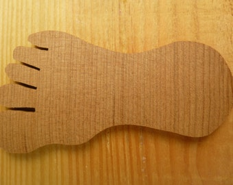 Redwood foot silhouette hand cut from reclaimed old growth stump in Humboldt California