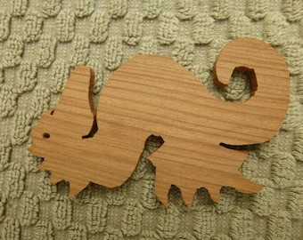 Redwood Seahorse silhouette hand cut from reclaimed old growth stump in Humboldt California