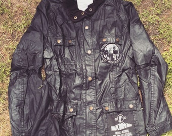 Waxy jacket with patches and pockets