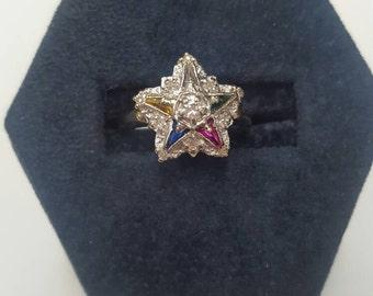 Multistone Eastern star gold ring